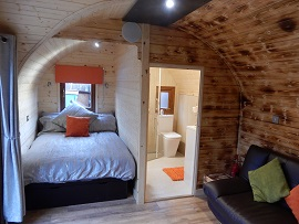 The Lodge Pod bedroom and en-suite view