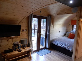 The Lodge Pod bedroom and entrance view